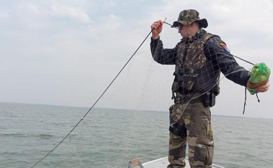 Itaipulândia: Polícias Ambientais apreende rede e espinhel quando averiguam denúncia de caça ilegal